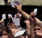 elections north akkar 1 -  Lebanese voters hold up their voting list at a polling station in Akkar